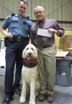 Casey R Doodle with members of the Seattle Police Dept., who presented the food bank with a check for $2,000, collected by donations from their dept. for the food bank.