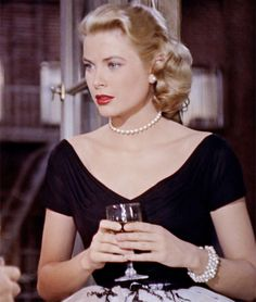 Grace Kelly in Hitchcock's, 'Rear Window'.  I love the way she wears her hair swept back off her face.