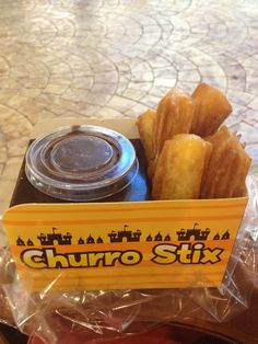 Eat+convenient. This is a very well designed churro stix box. When fast food is made eaten conveniently, life is so much easier. Usually they don't bother putting the dips/sauces into a compartment so that you can eat while walking, they just dump it into the bag of fries you bought! Took this photo on my short getaway to Bangkok a few weeks back.