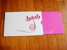 Pre-Invite for a lotus theme wedding - ivory laser cut sleeve with a beautiful textured pink fold-out invite. Simple yet attractive!
