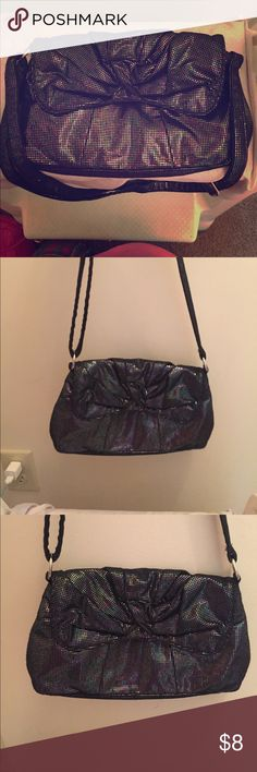 Oil slick metallic cross body or shoulder bag Oil slick metallic purse used as cross body or shoulder bag. Great for nights out, lots of room inside and soft fabric that won't snag. H&M Bags Crossbody Bags
