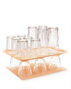 Save cabinet space by storing glassware on a serving tray - great idea and if you need a glass just pick up the tray. I'd put a non-slip mat in the trays though..