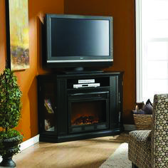 Terrific fireplace tv stand white only on homeeideas.com Tv Stand Next To Fireplace, Corner Electric Fireplace, Electric Fireplaces, Home Tv Stand, Diy Tv Stand, Corner Tv Stands, Cool Tv Stands, Costco, Innovation