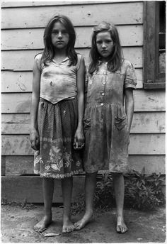 "Two girls with dirty clothes holding hands.  Kentucky, 1964  William Gedney. This picture makes me think of a book ""The Glass Castle"" that I just finished reading."