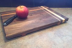 Cutting Board, Walnut w/ cherry/maple stripes & cherry feet. Nineteen79Woodwork visit 1979woodwork.com to view more pieces