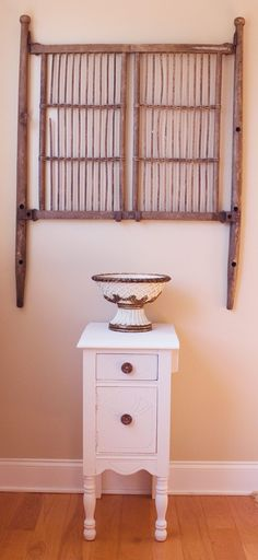 Antique Wood Baby Bed Headboard Paired With A White End Table
