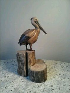 Woodcarving of a Pelican on Driftwood,bird carving, wildlife carving, wooden duck, duck decoy,wood carving, animal carving,driftwood art