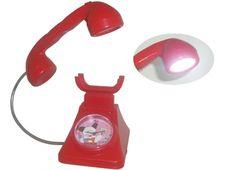 HELLO SPANK OROLOGIO SVEGLIA LAMPADA FORMA TELEFONO. Orologio sveglia Hello Spank love a forma di telefono in plastica di colore rosso, inoltre la parte della cornetta v dotata di una piccola lampada.