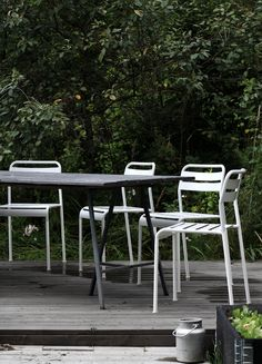 Dining Outdoors | Simply white & black | natural wood deck & green foliage background