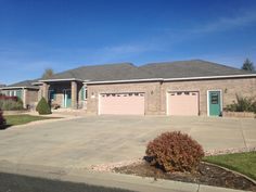 We installed Weathered Wood shingles from the GAF Timberline HD line of shingles on this home in Loveland.