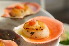 Scallops in the Shell - These scallops with ginger carrot dressing will add zest to the cocktail party menu.
