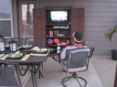 Outdoor armoire with tv. Heaven.