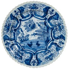 An 18th Century Blue and White Dutch Delft Charger ~such lively line!| From a unique collection of antique and modern delft and faience at http://www.1stdibs.com/furniture/dining-entertaining/delft-faience/
