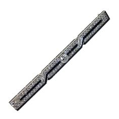 Art Deco J. E. Caldwell Diamond Onyx Platinum Bar Brooch | From a unique collection of vintage brooches at http://www.1stdibs.com/jewelry/brooches/brooches/