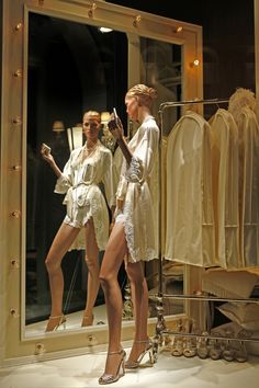 great idea having the garment rack in the window to showcase more clothes  Killer pose on the mannequin!
