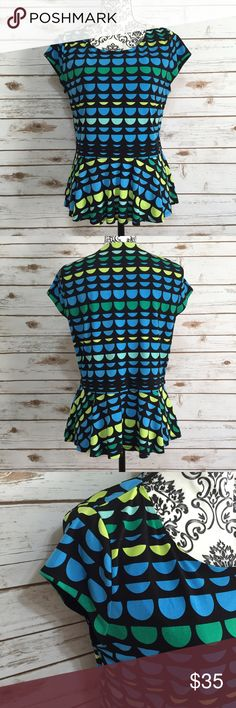 Vince Camuto peplum top Vince Camuto black peplum top with blue, green, & yellow semi circle designs. Size Large. 95% polyester 5% spandex. Lining is 100% nylon. Machine wash cold. Excellent used condition! Vince Camuto Tops