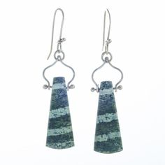 These are hand fabricated earrings using green Zebra stone and sterling silver. The green color would be described as forest green and the stripes are two tones with some opalescence in it. The arch design was inspired by the architecture of India.  The stones them selves are about 1 long, the entire earring is 2-1/8 from the very top of the ear wire to the bottom.  ready to ship.    For the stone healing folks:Zebra Stone can show us our own true natures and help us see past illusion. It is…