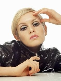 Twiggy - Eyeliner was the most important feature in makeup. Powder was still a popular thing. Pale lips to emphasize the eyes and false lashes on both the top and bottom lashes.