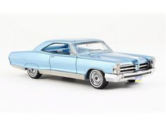 Pontiac Bonneville Coupe Resin Model Car by Neo 44104 This Pontiac Bonneville Coupe Resin Model Car is Metallic Blue. It is made by Neo and is scale (approx. Pontiac Bonneville, Diecast Model Cars, Metallic Blue, Plastic Models, Scale Models, Trucks, Kit Cars, Vehicles, Resin