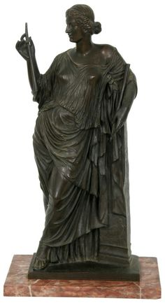 "F. Barbedienne (French, 1810-1892) Bronze Sculpture. The standing figure of Euterpe, the Greek muse of music is depicted leaning against a pillar and wearing long garments, she holds a pair of flutes in her hands; has a medium-dark brown patina and is on a marble base. Signed ""F. Barbedienne, Fondeur"" and medallion stamp on the back for ""Reduction Mecanique, A. Collas"". 21 in. high x 11 in. wide x 7.5 in. deep. Weight: 22.25 lbs."