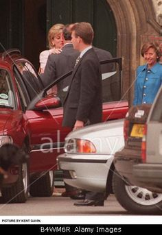 Stock Photo - Prince Charles and Princess Diana kissing after being at Eton College for Eton Open Day to see son Prince William May 1996