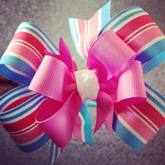 Large pink and blue snowcone pinwheel bow on a headband