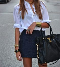classic navy mini + white blouse + bold accessories.