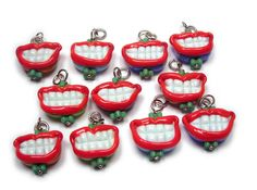 grinning charms for beads of courage by Lori Greenberg. I have one, I's saving it for a toothfairy pillow charm :)