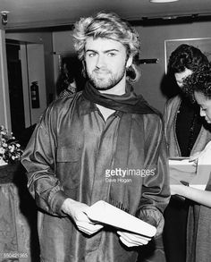 News Photo : Singer George Michael at the Ivor Novello Awards,...