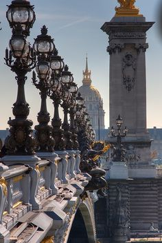 Alexander III Bridge, Paris, Ile-de-France, France; photo via etre Pont Alexandre III is an arch bridge that spans the Seine, connecting the Champs-Élysées quarter and the Invalides and Eiffel Tower Quarter, regarded by many as one of the prettiest in Paris.