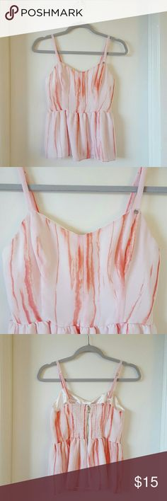 Guess Peplum Top Tie Dye Pink Peplum Tank Top. Size M. Lightly worn. Great Condition. Has a tie dye print all over with a double layer inside. Not see through. Ajustable straps and a zippered back and stretch for added extra comfort and adjustment options. Guess Tops Tank Tops