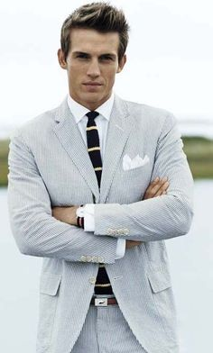 Seersucker suit, white shirt, navy knit tie with yellow stripes