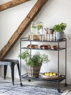 A industrial style drinks trolly on wheels.A stunning Drinks Trolley in metal, to add that industrial look to your home! Complete the look with a number of delicious cocktails or could be used for storage around your house.MetalW: H: L: 76 Bar Trolley, Serving Trolley, Kitchen Trolley, Drinks Trolley, Bar Carts, Cosy Corner, Decorative Storage, Slow Living, Small Space Living