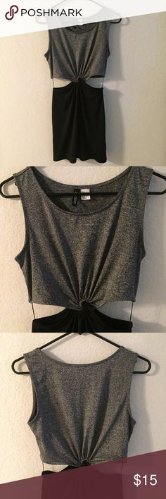 H&M Divided Cut-out Bodycon Dress Stretchy body con dress from Divided by H&M. Grey top and Black skirt woven together in center with cut-out sides. Never worn. Perfect condition. Size small can fit a 2/4/6 H&M Dresses Mini