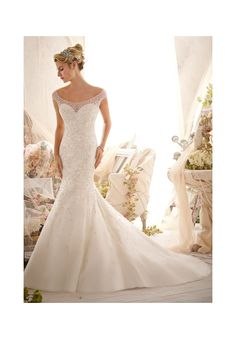 Wedding Dresses and Wedding Gowns by Morilee featuring 2617 Elaborate Allover Beading Design on Net This stunning gown features an illusion off the shoulder neckline scattered with beading, perfectly accenting the underlying sweetheart bodice. Elaborate beading tapers off beautifully into the flared skirt. The illusion back is also accented with beading and covered buttons. Colors Available: White/Silver, Ivory/Silver, Light Gold/Silver. Sizes Available: 2-28.