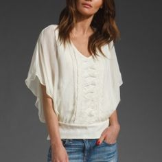 Anthropologie Romantic Top Romantic Cream Top | 100% Silk | Good Condition, however has slight discoloration on right sleeve (about the size of a golf ball), I have not tried to wash it, so it's likely to come out. Other than this, the shirt is in great condition. Price reflects flaw. Anthropologie Tops