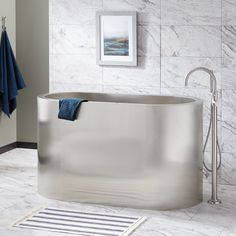 Simple yet stunning, the Minato Brushed Stainless Steel Japanese Soaking Tub features a smooth, oval design, deep interior, and two integral seats. Pair with a tall freestanding tub filler to complete your in-home spa. Tubs For Sale, Japanese Soaking Tubs, Clean Bathtub, Freestanding Tub Filler, Soaker Tub, Soaking Bathtubs, Tub Faucet, Brushed Stainless Steel, Bath