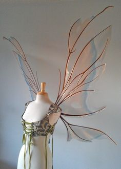 Making fairy wings is a wonderful way to conserve money on a Halloween costume or produce an excellent gift for a kid. While the most basic fairy wings can be used simply coardboard, you can make even Kleidung Design, Poster Design, Fantasy Costumes, Fairy Costumes, Fairy Wings Costume, Diy Fairy Wings, Woodland Fairy Costume, Diy Wings, Character Outfits