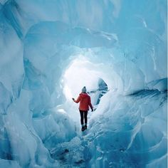 Stunning image of @helloemilie from inside Fox Glacier in New Zealand.