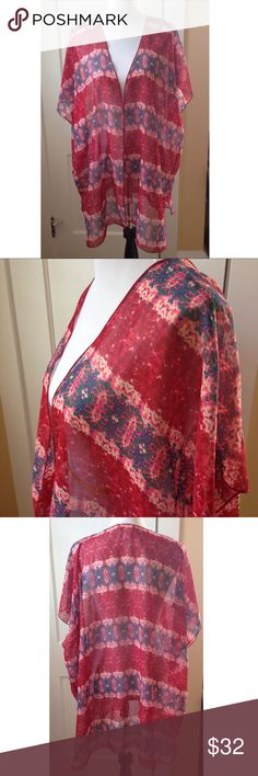 BAND OF GYPSIES Boho Chic Kimono NWOT Perfect for any boho chic wardrobe, make this mid-length tribal print kimono by Band of Gypsies yours today! New without tags and in perfect condition! Band of Gypsies Tops