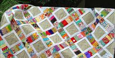 This Easy Project Will Stitch Together Quickly! Pull out your most colorful and beautiful scraps for an easy quilt that will go together quickly. Choose a color to tie everything together, like the tan chosen by the designer. Any favorite color that complements your scraps will be lovely. Finish the quilt off with easy machine …