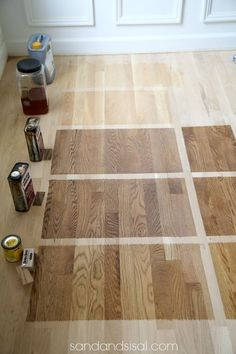 Choosing Floor Stains: Top- bottom- 1) Waterborn clear coat 2) Polyurethane 3) DuraSeal Nutmeg Stain 4) Duraseal Provincial Stain 5) Minwax Weathered Oak. Note: DuraSeal Stains are by Minwax. Left side 80 grit sanded, right side 150 gril sanded. The level of sanding effects the stain appearance.