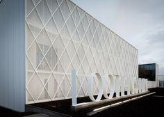 Diamond-shaped fencing shrouds Belgian office and workshop