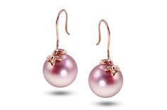 Gemstone Spotlight: Imperial Pearl. This matching earring set features 13 to 14 mm natural color pink Imperial Windsor freshwater pearls set in a 14-karat rose gold floral design with diamond accents ($425).