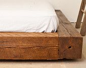reclaimed wood bed frame- This would be awesome for a rustic themed bedroom. However you need to have some risers under it.