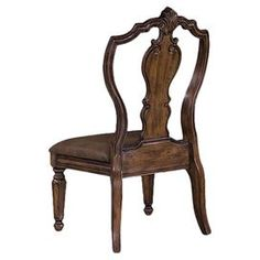 """Evoking Old World Italy, the ornately carved openwork back and turned front legs of this handsome side chair lend a regal air to your well-appointed dining room.  Product: ChairConstruction Material: Wood, cotton, and polyesterColor: BrownDimensions: 45.5"""" H x 21.9"""" W x 28.6"""" D"""