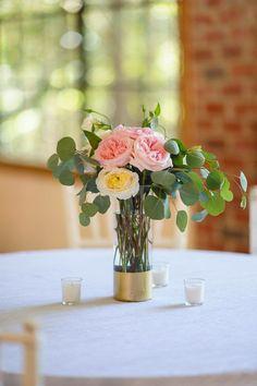 Simple arrangement of garden roses and eucalyptus