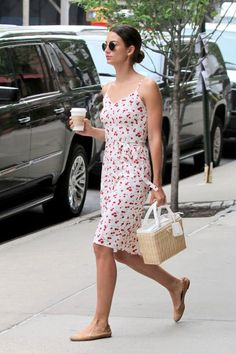 Model Lily Alridge grabs a #coffee in NYC wearing an HVN dress. #modelstyle #fashion