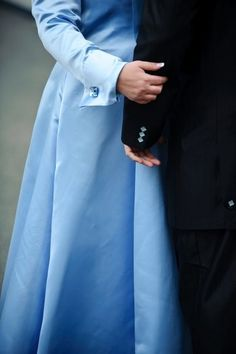 My wedding dress, made of baby blue silk in which I designed and Amai Unmei from Portland, Oregon made for me. Included a 27 foot train! Cuff-links by Swarovski Crystal!