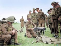King George VI inspects the skills of a blindfolded Australian Vickers machine gunner from the 2/1st Machine Gun Battalion, 18th Brigade, 6th AIF Division which was based in the United Kingdom in 1940.  (Possible taken at Colchester during October 1940)